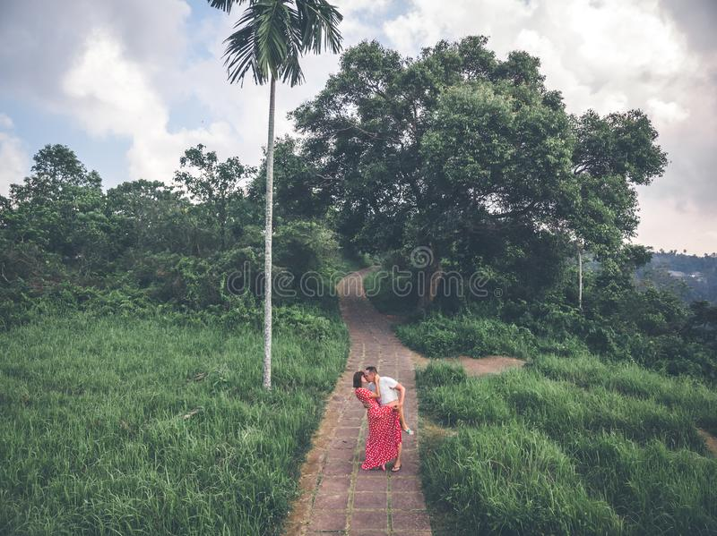Young couple posing on the road in the jungle of Bali island. royalty free stock photography