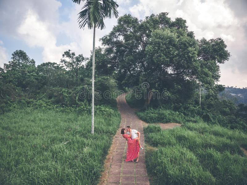 Young couple posing on the road in the jungle of Bali island. Indonesia royalty free stock photography