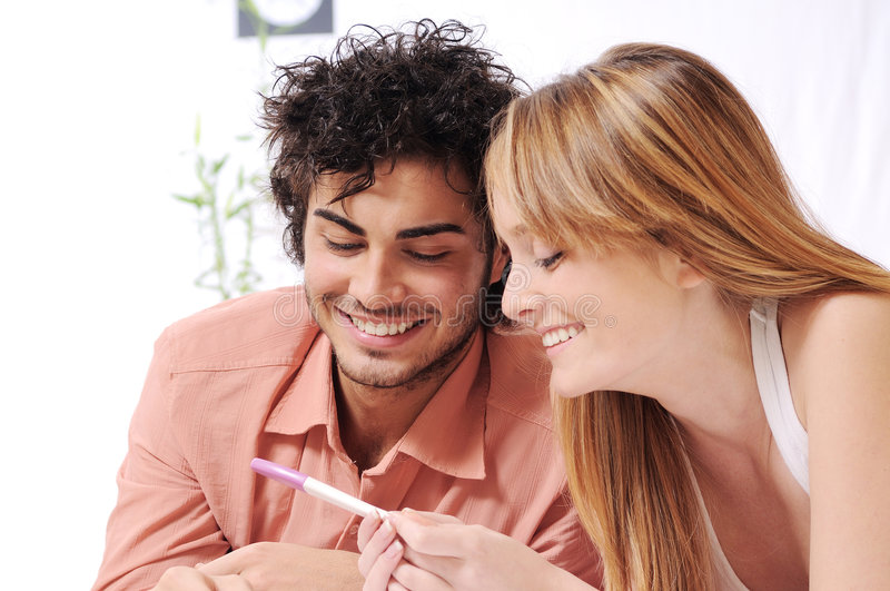 Young couple and pregnancy test royalty free stock photo
