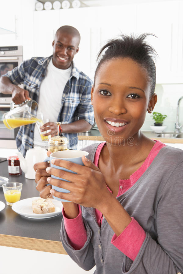 Young Couple Preparing Breakfast In Modern Kitchen. Young Couple Preparing Breakfast In A Modern Kitchen stock images