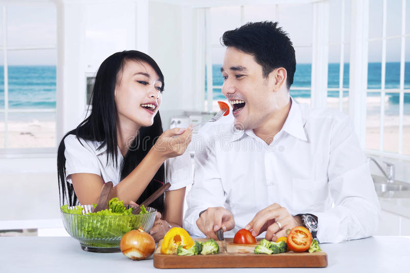 Young couple preparing healthy food royalty free stock image