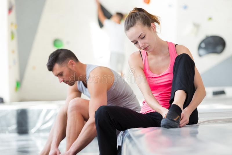 Young couple preparing themselves for climbing activity royalty free stock images