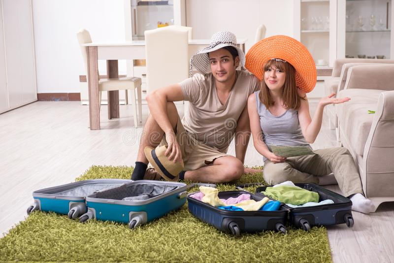 Young couple preparing for trip royalty free stock photo