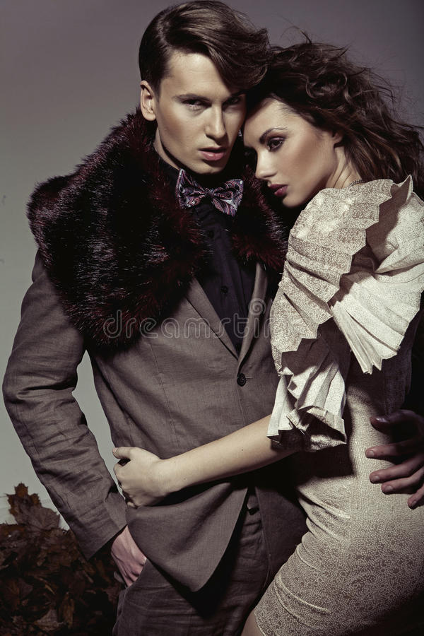 Young Couple Presenting An Autumn Fashion Royalty Free Stock Photo