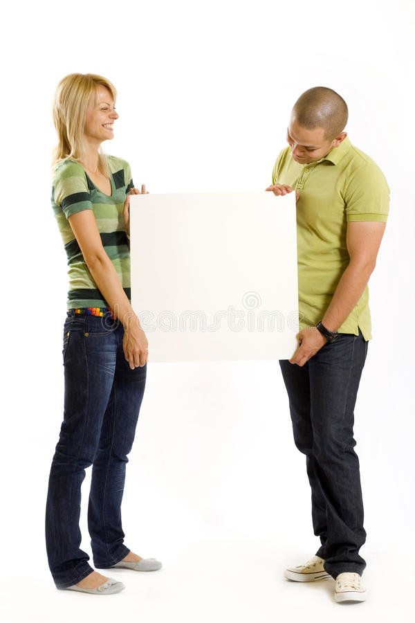 Young Couple Presenting A Blank Board Royalty Free Stock Images
