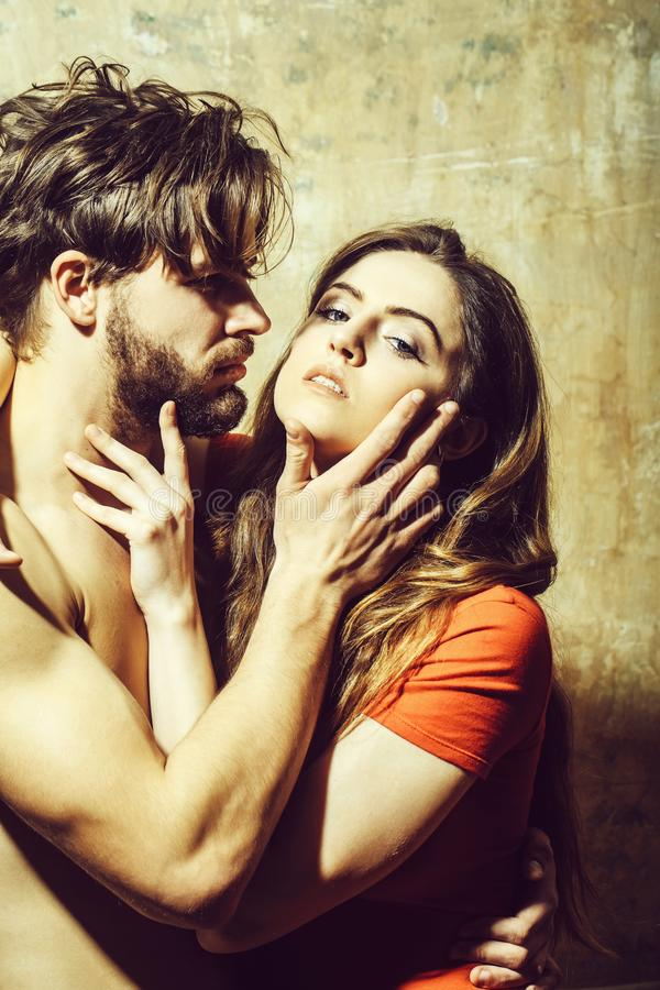 Young couple of pretty girl and bearded man hugging stock photography