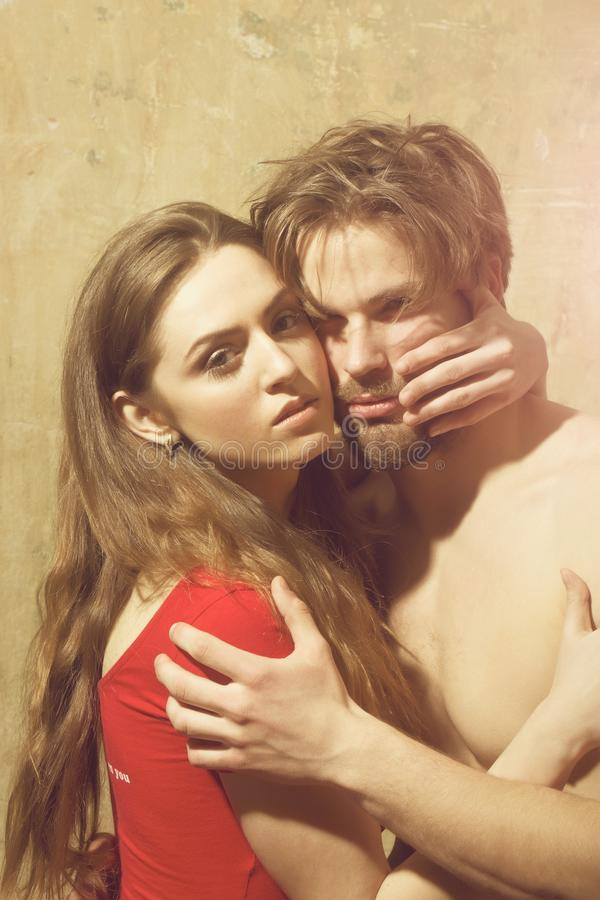 Young couple of pretty girl and bearded man hugging royalty free stock photo