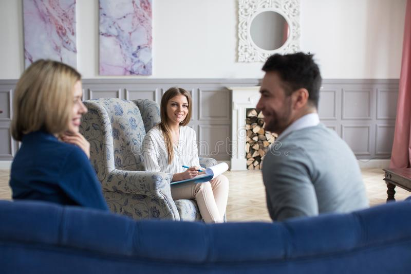 Young couple at a professional psychologist at the consultation stock photo