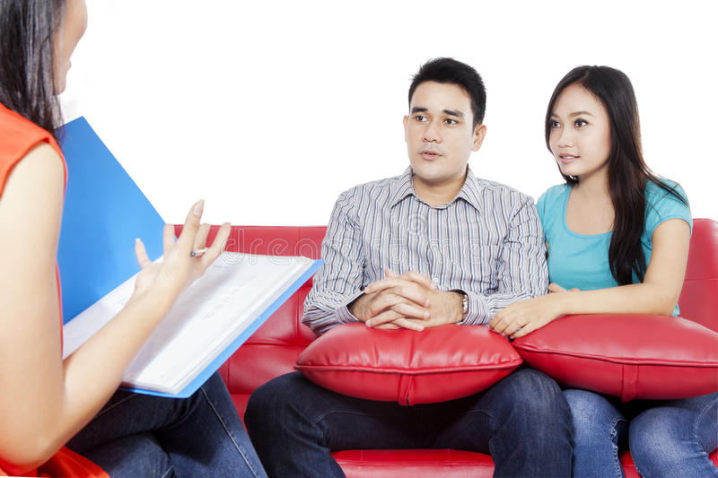 Young couple and psychiatrist. Young couple consulting with psychiatrist, isolated on the white background stock photography