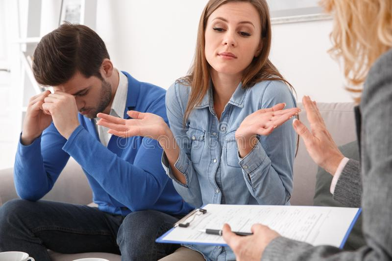 Young couple with psychologist family therapy confused stock photos