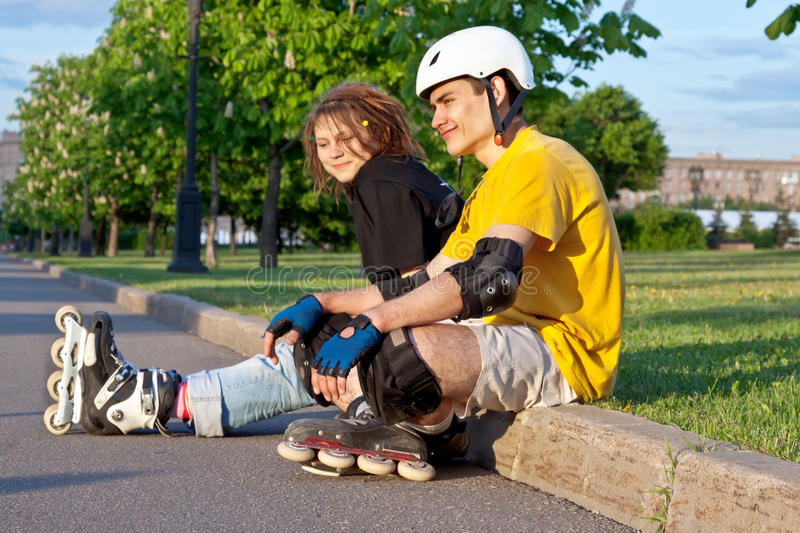 Download Young Couple Put On Inline Skates Stock Image - Image: 18258243
