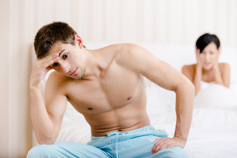 Young couple quarrels in bed royalty free stock photos