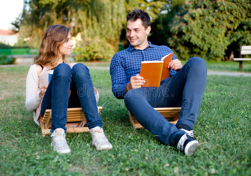 Young couple reading a book