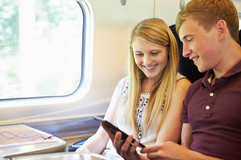 Download Young Couple Reading A Book On Train Journey Stock Image - Image: 33574935