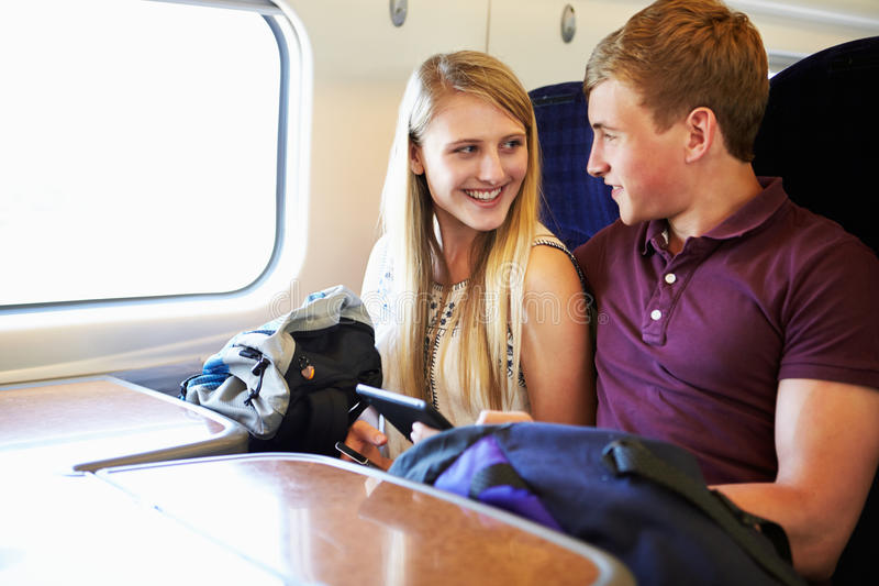 Download Young Couple Reading A Book On Train Journey Stock Image - Image: 33575067