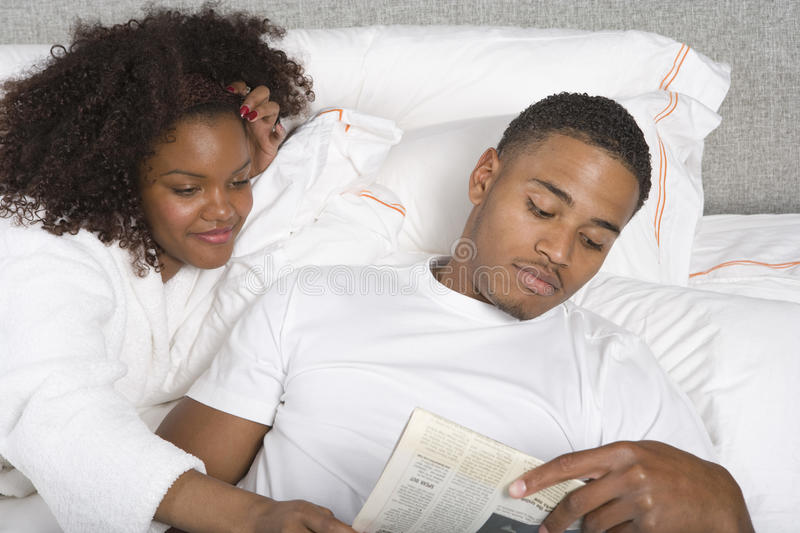 Download Young Couple Reading Newspaper Together Stock Photo - Image: 29650372
