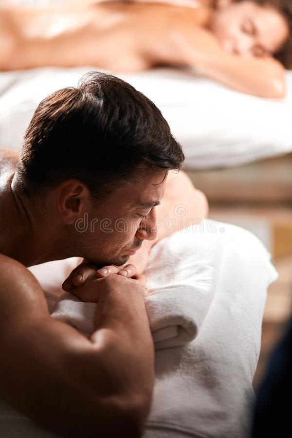 Young couple receiving a back massage in a Spa center royalty free stock images