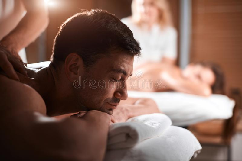 Young couple receiving a back massage in a Spa center royalty free stock photos