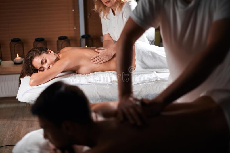 Young couple receiving a back massage in a Spa center stock photo
