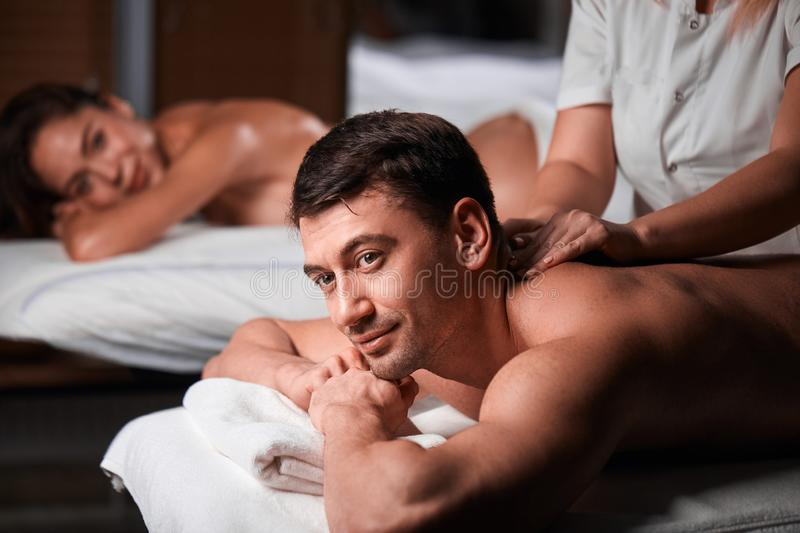 Young couple receiving a back massage in a Spa center royalty free stock photo