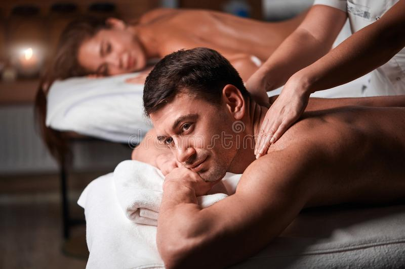 Young couple receiving a back massage in a Spa center royalty free stock image
