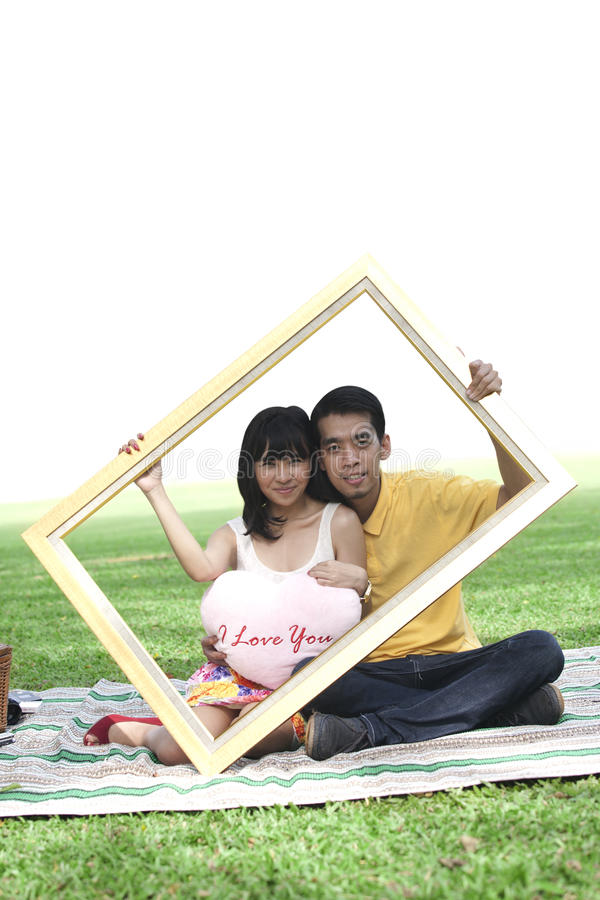 Download Young Couple With Rectangle Frame Stock Images - Image: 22902034