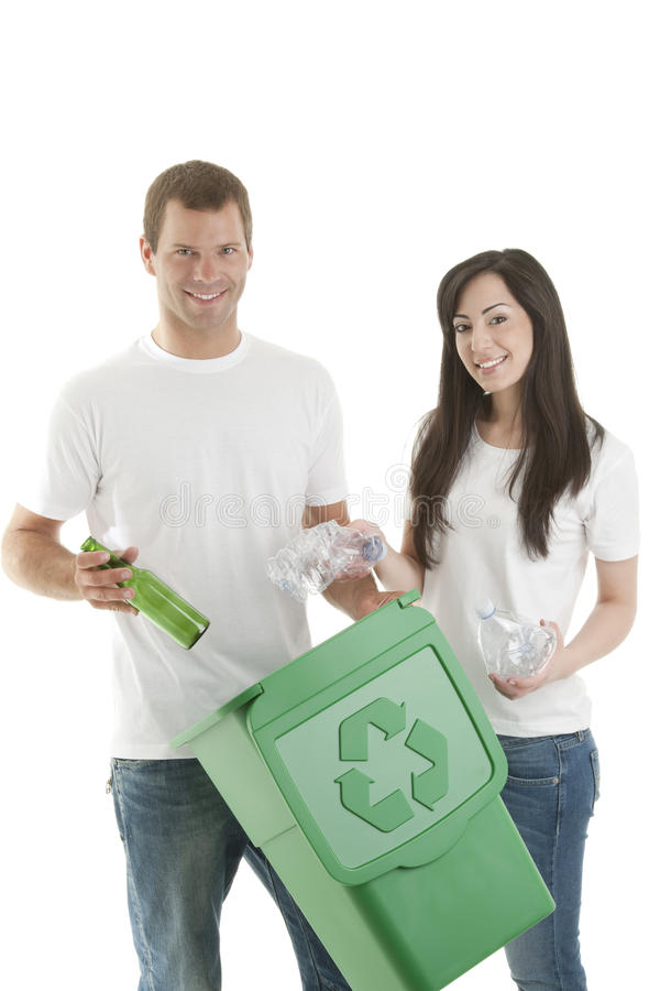 Young couple recycling. Portrait of young couple recycling stock photo