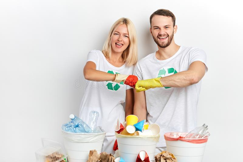 Young couple rejoicing at successful day of recycling waste royalty free stock image