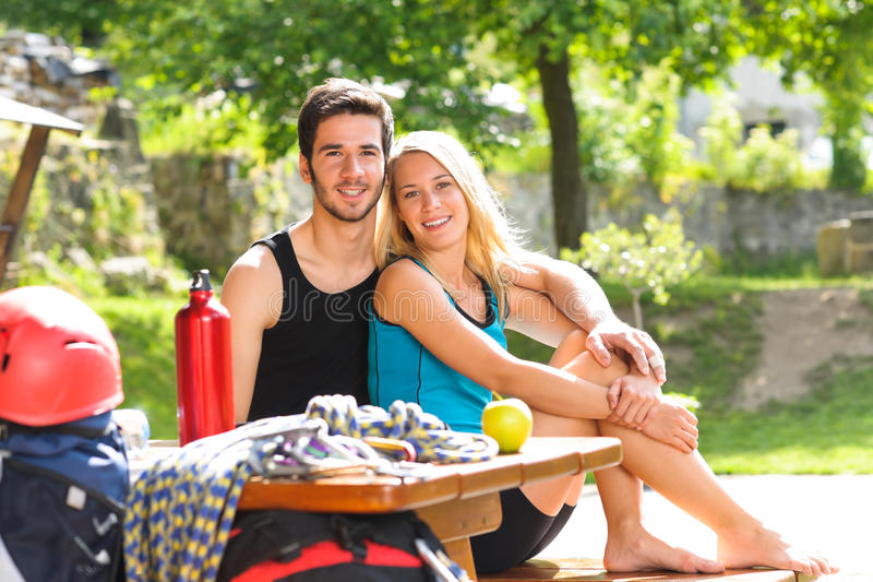 Young couple relax sunny terrace climbing gear. Backpack active young couple relax with climbing gear sunny terrace stock image