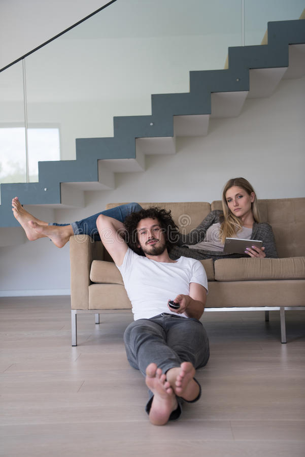 Download Young Couple Relaxes In The Living Room Stock Photo - Image: 83715394