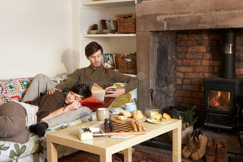 Download Young Couple Relaxing By Fire Stock Photo - Image: 21410674
