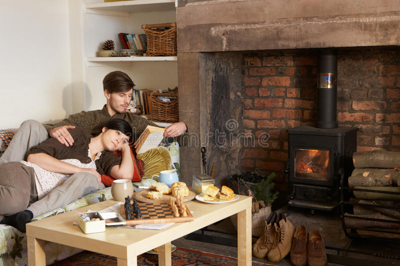 Download Young Couple Relaxing By Fire Stock Photo - Image: 21410704