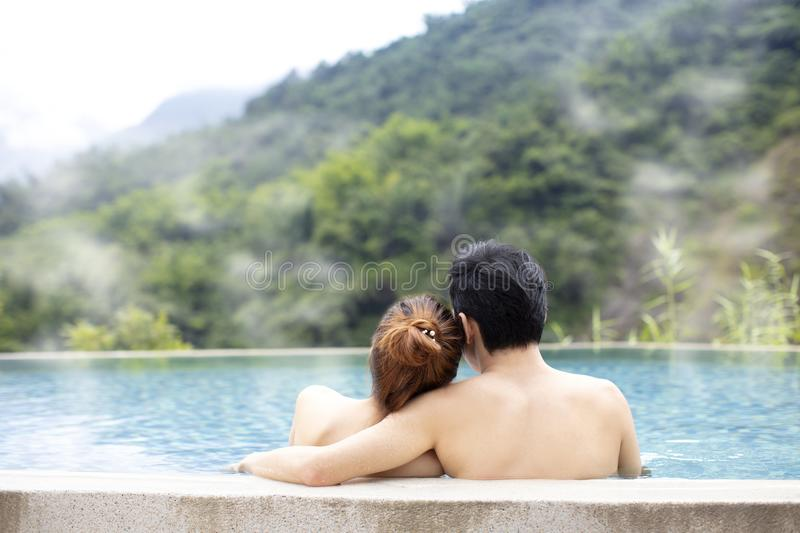 Young couple relaxing in hot springs. Young asian couple relaxing in hot springs royalty free stock photos