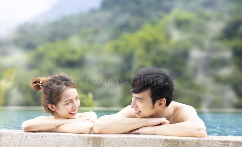 Young couple relaxing in hot springs. Young asian couple relaxing in hot springs royalty free stock photo