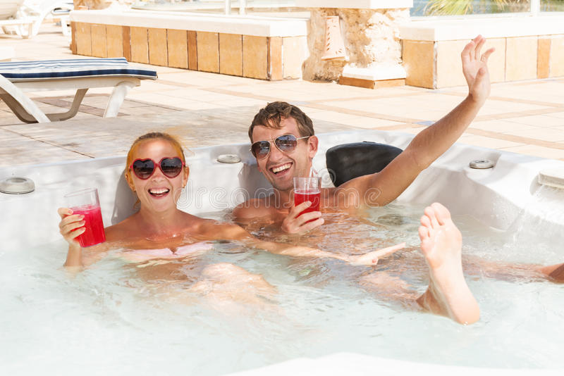 Download Young Couple Relaxing In Jacuzzi Pool Stock Image - Image: 31334541