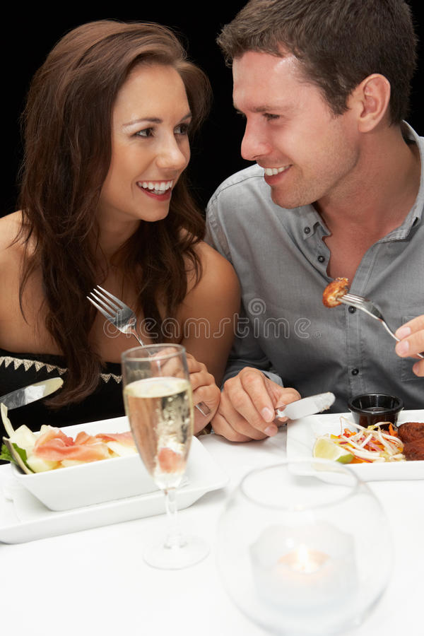 Young couple in restaurant royalty free stock images