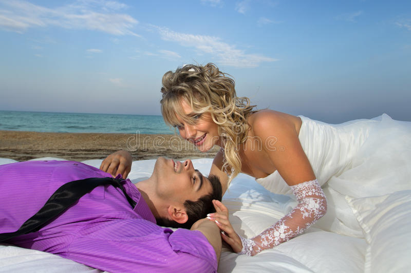 Download Young Couple Resting In Bed Stock Photo - Image of awake, nuptials: 26886412
