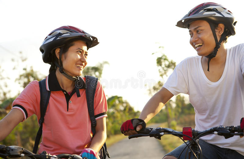 Download Young couple riding bike stock image. Image of summer - 42346021