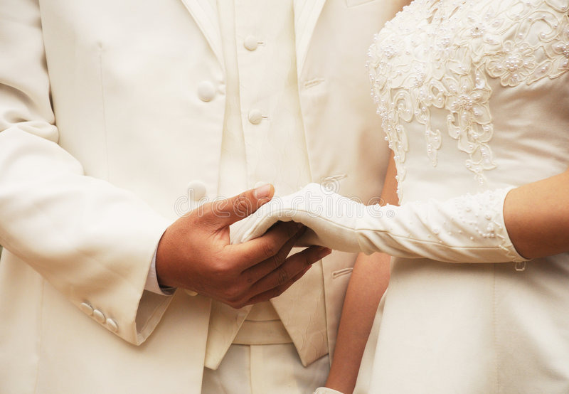 Young couple in robe holding hands royalty free stock photo