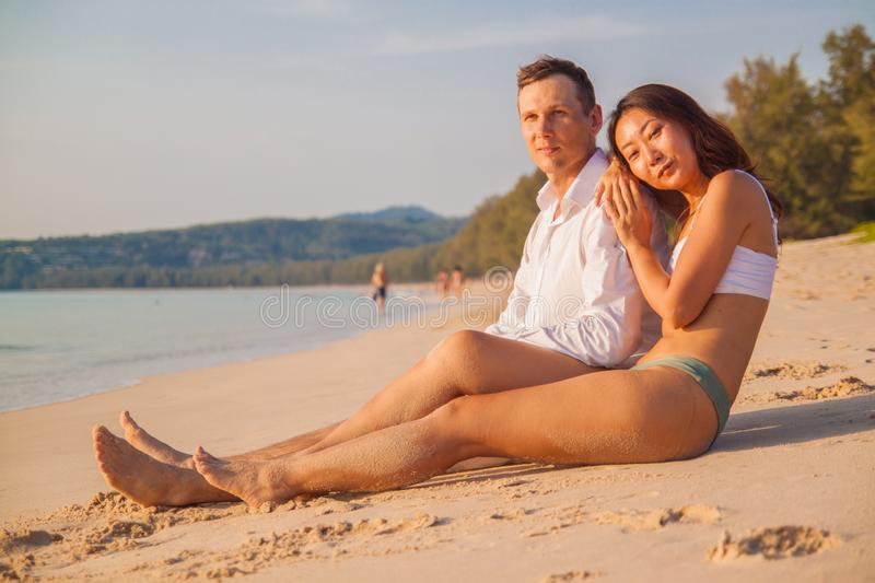 Young couple in romantic mood enjoying on the beach. royalty free stock photos