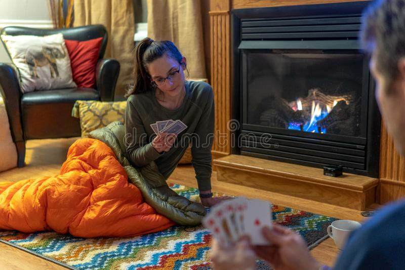 Young couple romantically talking drinking hot cocoa and sleeping bags Keeping warm with down blankets by the fire stock photos