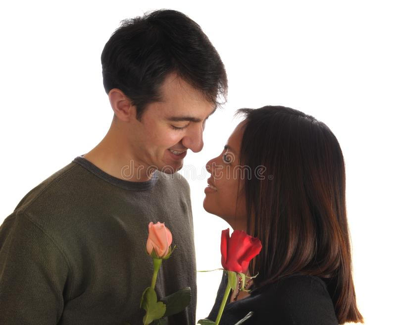 Young couple with roses stock image