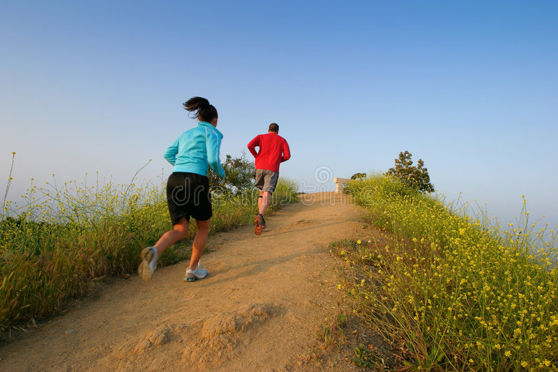 Download Young couple running stock image. Image of jogging, mountain - 2041557