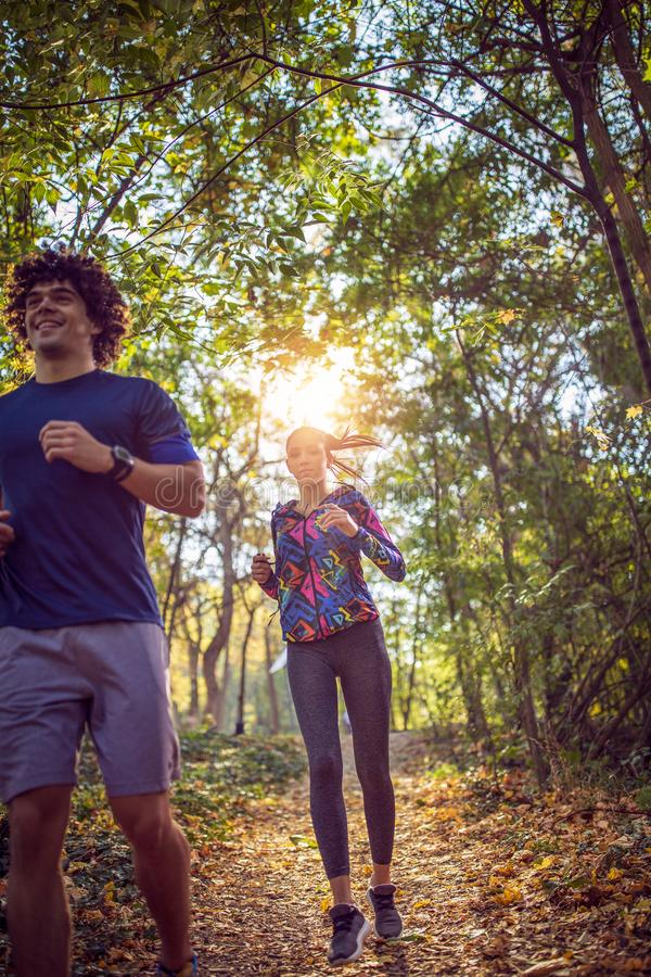 couple running at the nature- fitness, sport, training and lifestyle concept. royalty free stock image