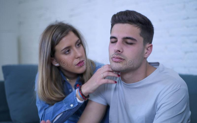 Young couple 20s with man sad and depressed suffering pain maybe broken heart and girlfriend giving her boyfriend support help and. Young couple 20s sitting at stock photo