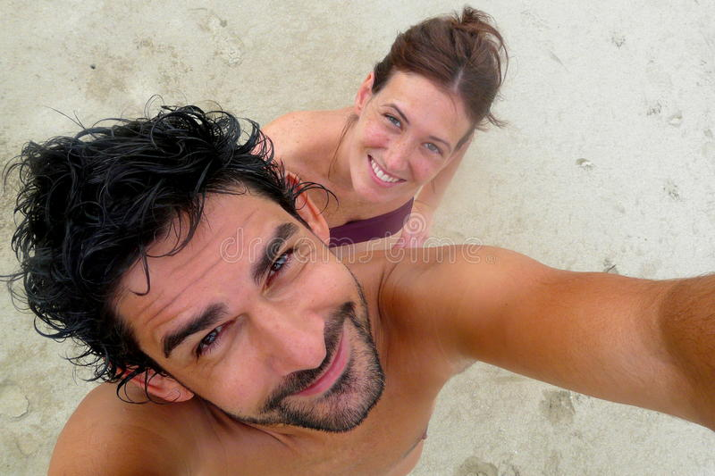 Young couple's portrait in Punta Uva beach, Puerto Viejo, Costa Rica stock photography