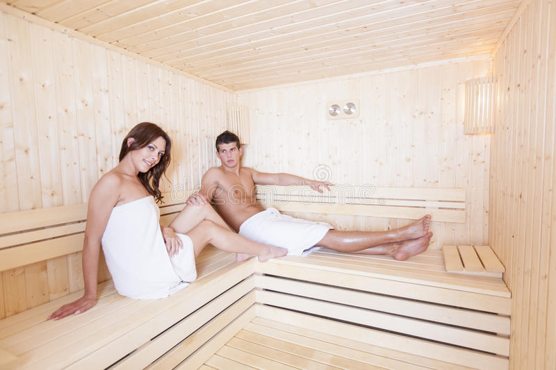 Young couple in the sauna royalty free stock photos