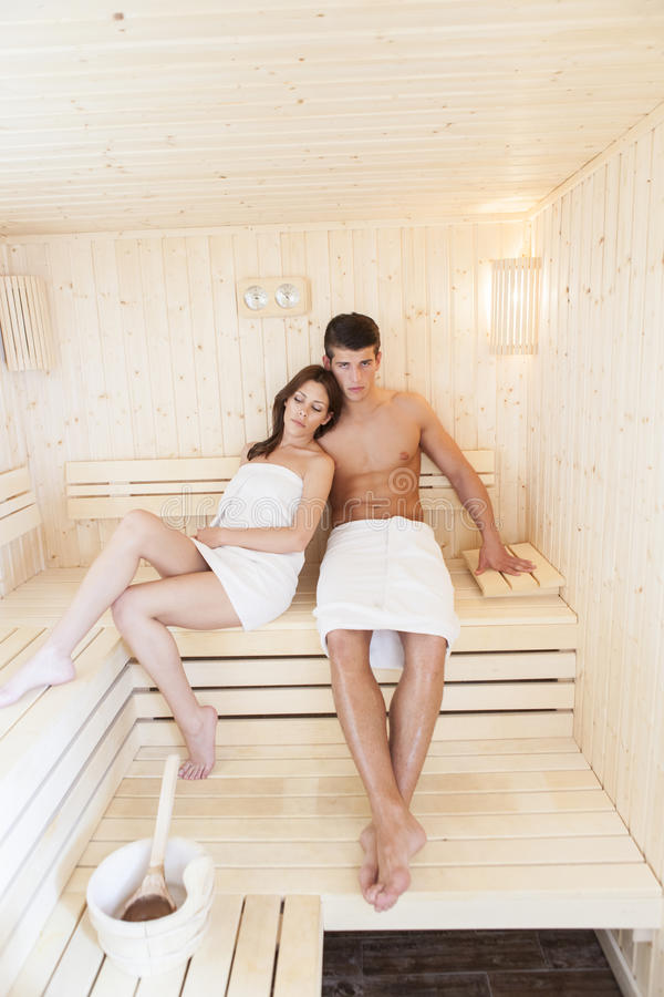 Young couple in the sauna stock photo
