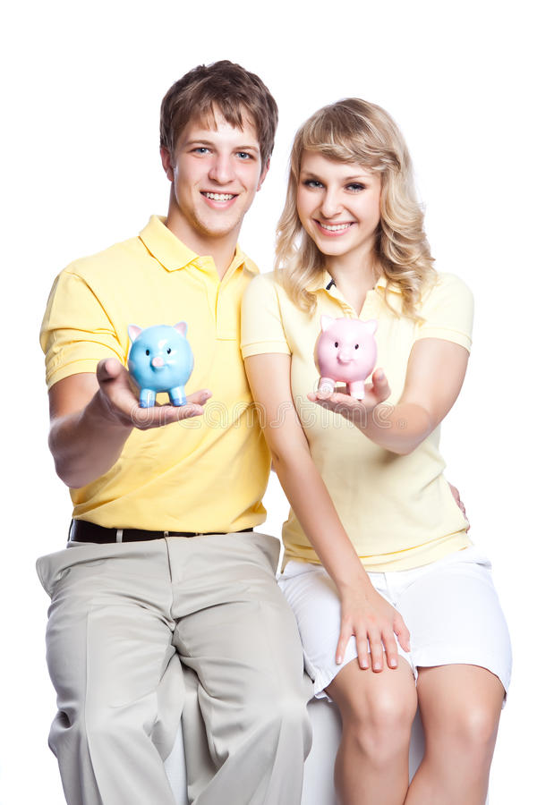 Young couple saving money royalty free stock photo
