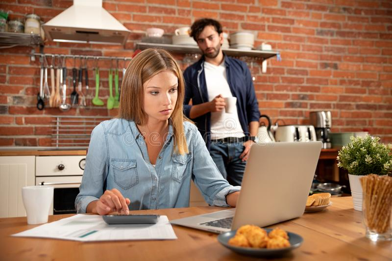 Young couple in savings and home budget concept stock photography